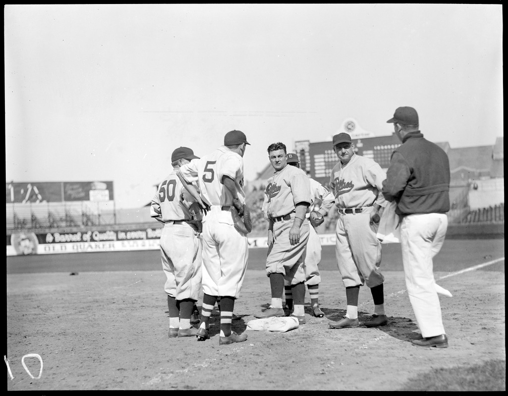 Boston Braves and Philadelphia Phillies grouped around first base at Braves Field