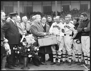 Presentation of suitcase at Braves Field, manager Bill McKechnie looks on
