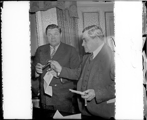 Babe Ruth and Judge Fuchs smoke cigars to celebrate Ruth signing with Braves