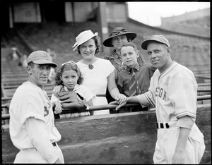 Boston Bees players pose with women and children in stands