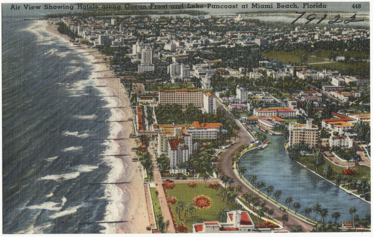 Air view showing hotels along ocean front and Lake Pancoast at Miami Beach, Florida