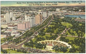 Aerial view showing band shell in Bayfront Park, Biscayne Bay, and bayfront hotels, Miami, Florida