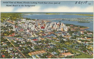 Aerial view of Miami, Florida looking north east shows part of Miami Beach in the background