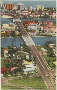 View showing New Indian Creek Bridge and ramp at 61st Street, St. Francis Hospital on right, Miami Beach, Florida