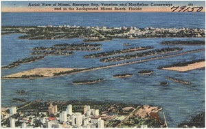 Aerial view of Miami Biscayne Bay, Venetian and MacArthur Causeways and in the background, Miami Beach, Florida