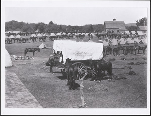 World War I encampment on Pelham Island with camp tents and covered wagon