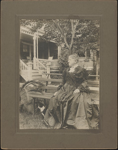 Mrs. Warren G. (Cynthia) Roby sitting on the lawn in front of her home on Concord Road