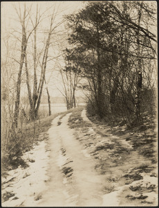 Country road in winter overlooking the Sudbury River