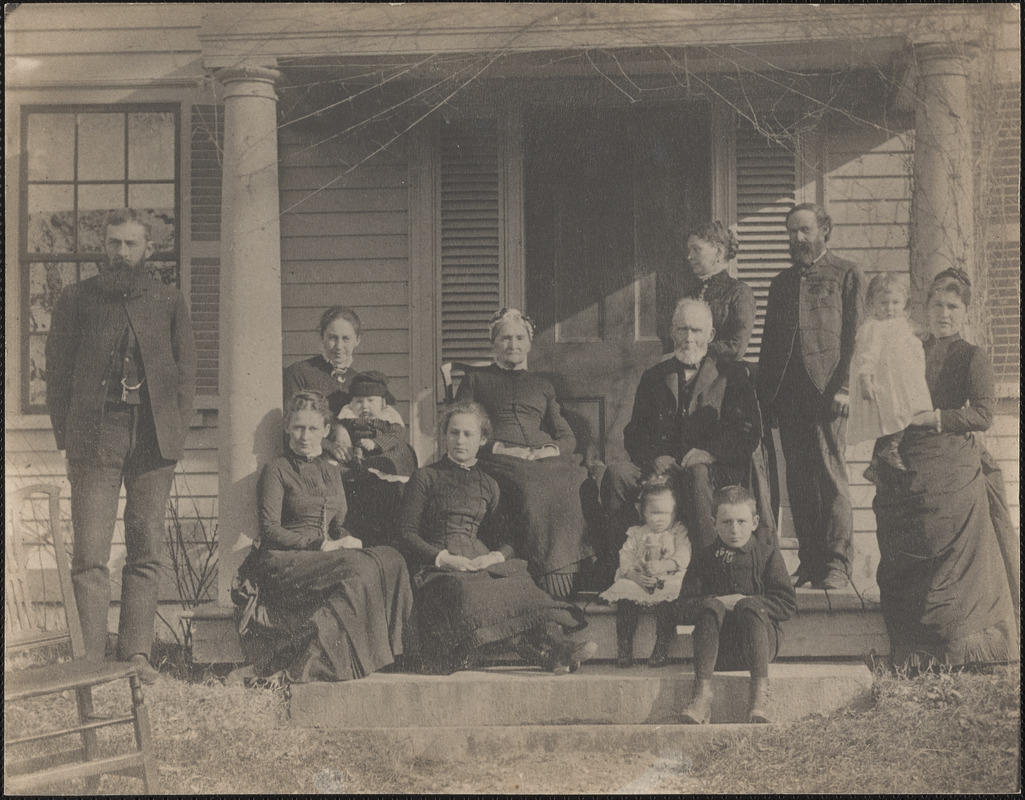 Mr. & Mrs. Jude Damon on the front steps of their house with eleven others