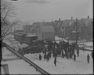 Biggest snow blizzard in 22 years causes narrow gauge train to turn turtle at Beachmont. House with barn is 104 Washburn Ave., Revere.