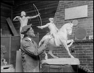 Cyrus Dallin, sculptor, working on Paul Revere statue