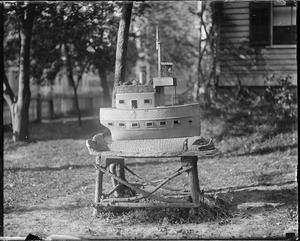 Small concrete ship in front yard at 29 Charles St., Dorchester