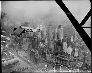 Liberty bellanca monoplane in the air (over NYC) on first leg of its flight to Denmark. From Hasbrouck Heights, N.J. with Otto Hillig of Liberty, N.Y., flying photographer and Capt. Hoérüs, the pilot.