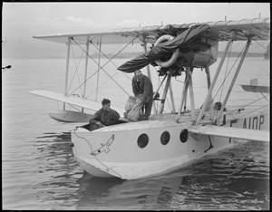 First mail by water plane lands in Boston Harbor, 1928. Radio operator Marcel Mourion of the Ilede France seaplane, which landed here yesterday afternoon, is about to disembark with two of the mail pouches. The craft reached Boston inner harbor 10 hours after...