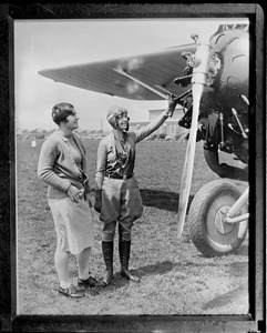 17-year-old aviatrix Elinor Smith showing aeroplane to 18-year-old golf star Helen Hicks - Fairchild Field, Farmingdale, N.Y.