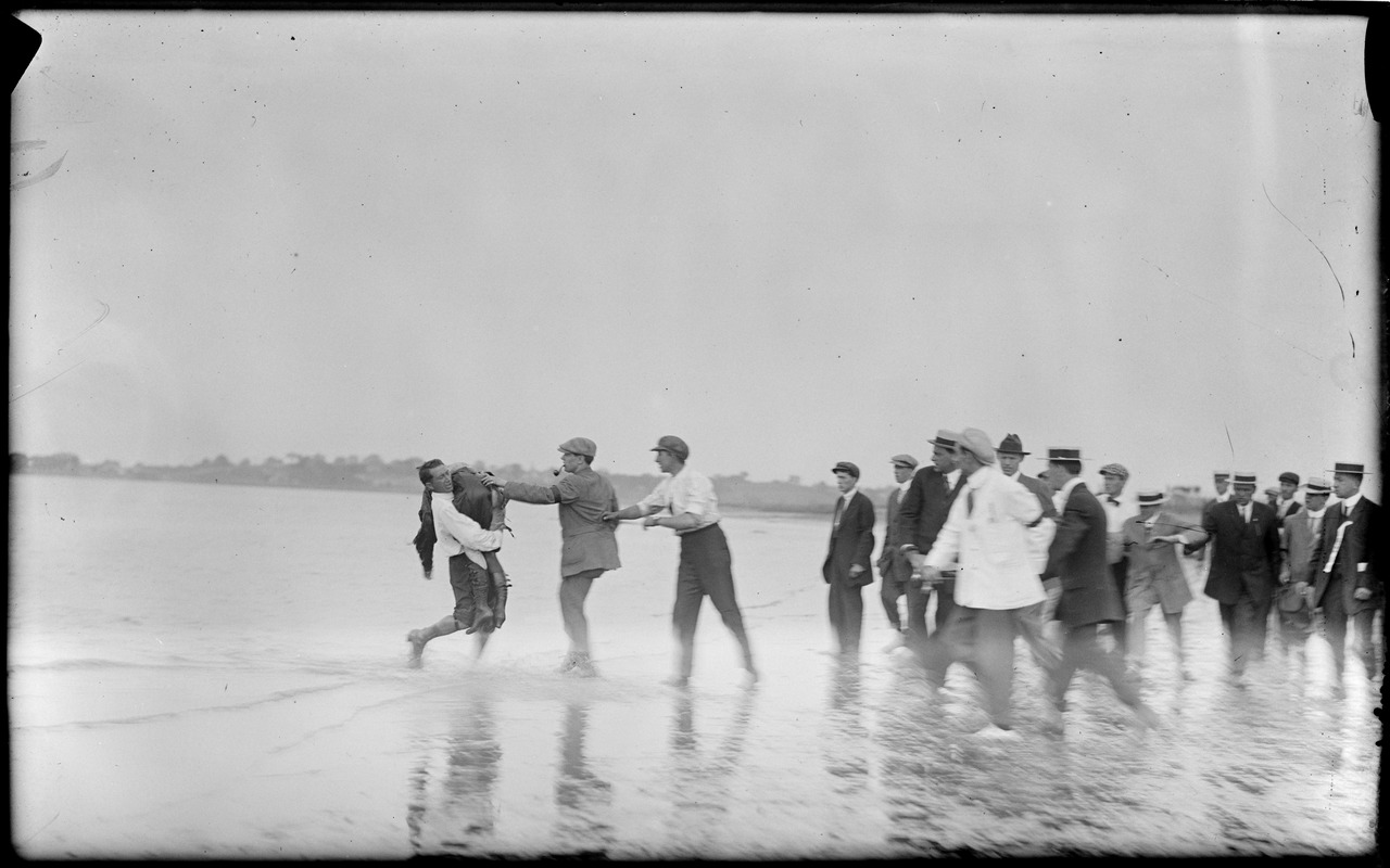 Quimby girl taken from marsh at Squantum after falling from her airship, Harvard-Boston aero meet