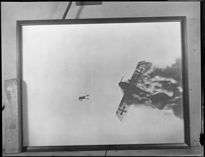 WWI dog fight, German pilot bails out of burning plane