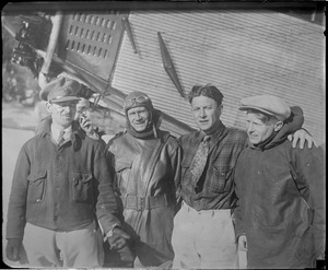 R-R: Maj. James Fitzmaurice, Irish transatlantic flyer, Floyd Bennett, pilot of Byrd's North Pole plane, Duke Schiller, who flew 1st plane to Greenly Island, and Bernt Balchen, pilot of Byrd's transatlantic flight, standing next to Ford monoplane that went to assist German fliers at Lake Ste. Agnes, Quebec.