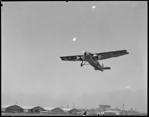 Ford trimotor in flight, East Boston Airport