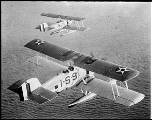 Military sea planes in flight over water