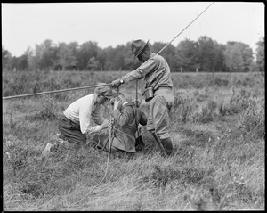 Tieing a photographer to man-kite ropes at Fort Devens