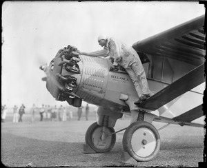 Boardman checking engine of plane at East Boston Airport.