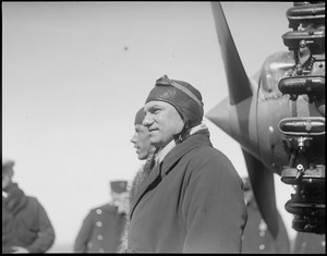 Foreground - Charles A. Levine. Background - pilot Wilmer Stultz arriving at East Boston Airport.