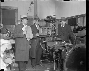 Lottery seizure: R-R: Inspector Edward J. Glennon / Sgt. Charles Presho / Inspector Joseph B. Breen, with seized printing apparatus.