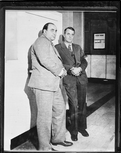 Al Capone and attorney Michael Ahern held for evading income tax