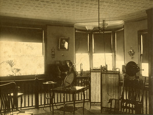 Charles Eugene Monroe in his first optometry office in Southbridge Massachusetts