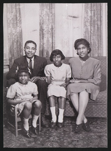 "Brandford Burke, Keitha's father, Henrietta ""Yetta"" Burke (nee Brown), Keitha's mother, and Keitha Burke Hassell. Beverley Burke (Keitha's sister) on chair"