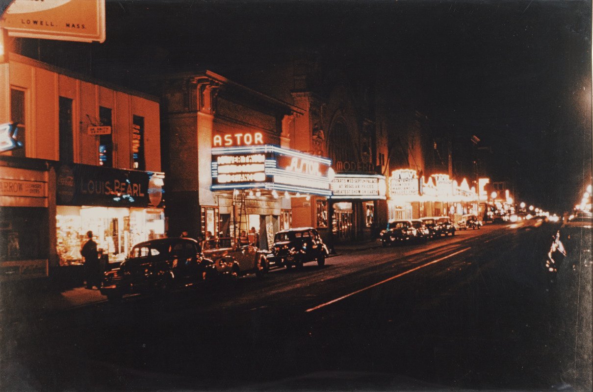Four movie theaters that were located on Broadway in Lawrence, Mass. at night