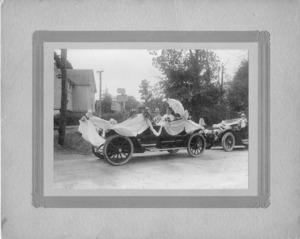 Mr. and Mrs. E.L. Thompson in Parade Car