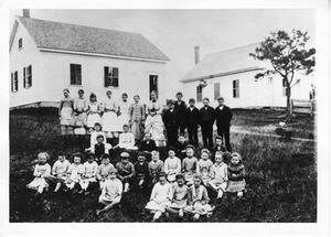 A group of schoolchildren outside the No. 6 School