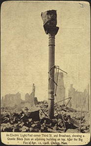 An electric light post corner Third St. and Broadway, showing a granite block from an adjoining building top. After the big fire of Apr. 12, 1908. Chelsea, Mass.