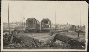 Two street cars and ruins of the Great Chelsea Fire