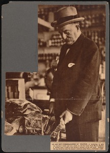 Charles S. Ashley cutting steak at butcher shop