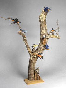 View of minature birds on driftwood