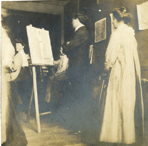 Faculty with students in studio