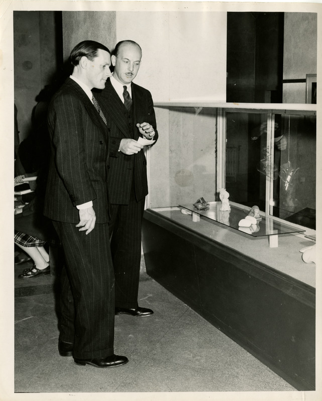 President with faculty member at exhibit