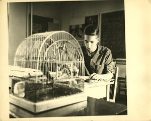 Student with birdcage