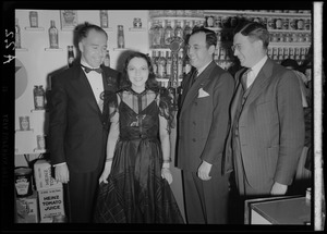 Ireene Wicker with three unidentified men with WAAB microphone