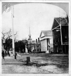 Town Hall, John Lenox's barber shop and the Spring Hotel on Main Street.