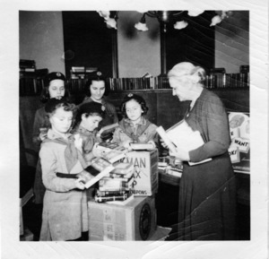 "Librarian Lydia Masters and five Girl Scouts packing boxes for the ""Books for Servicemen"" program during World War II. Watertown Free Public Library, 1943."