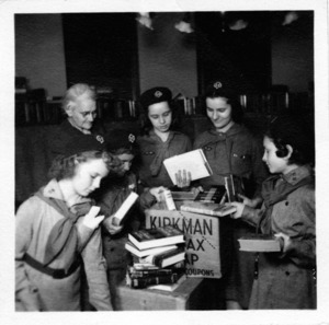 Library and Girls Scouts helping soldiers.