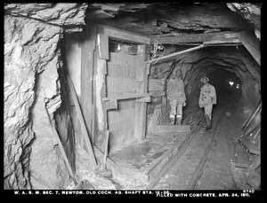 Distribution Department, Weston Aqueduct Supply Mains, Section 7, old Cochituate Aqueduct shaft, station 16+88, filled with concrete, Newton, Mass., Apr. 24, 1911