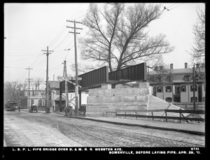 Distribution Department, Low Service Pipe Lines, pipe bridge over Boston & Maine Railroad at Webster Avenue, before laying pipe, Somerville, Mass., Apr. 29, 1911