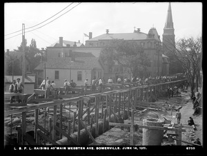 Distribution Department, Low Service Pipe Lines, raising 48-inch main Webster Avenue, Somerville, Mass., Jun. 14, 1911