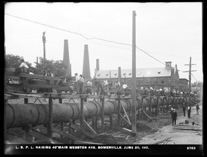 Distribution Department, Low Service Pipe Lines, raising 48-inch main, Webster Avenue, Somerville, Mass., Jun. 20, 1911