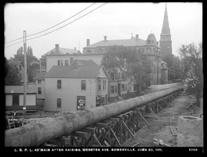 Distribution Department, Low Service Pipe Lines, 48-inch main after raising, Webster Avenue, Somerville, Mass., Jun. 20, 1911
